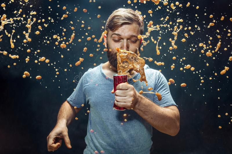 Man drinking a cola and enjoying the spray. stock images