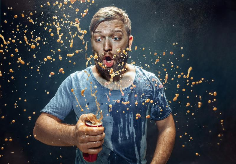 Man drinking a cola and enjoying the spray. royalty free stock photo