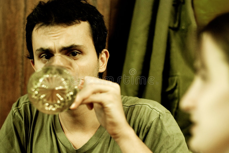 Man drinking from large mug stock photos