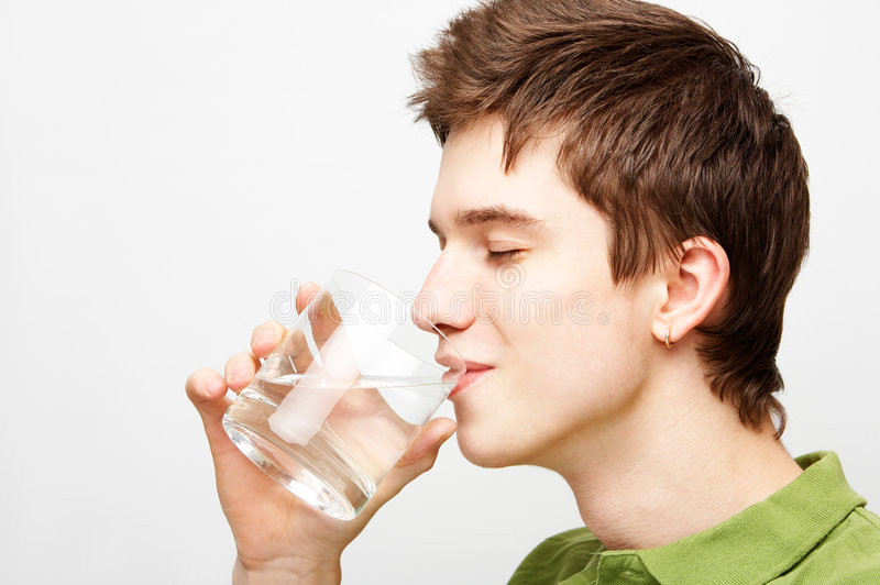 Man is drinking mineral water stock images
