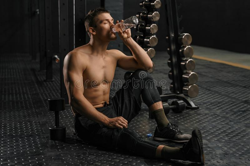 Man drinking water after hard training royalty free stock images