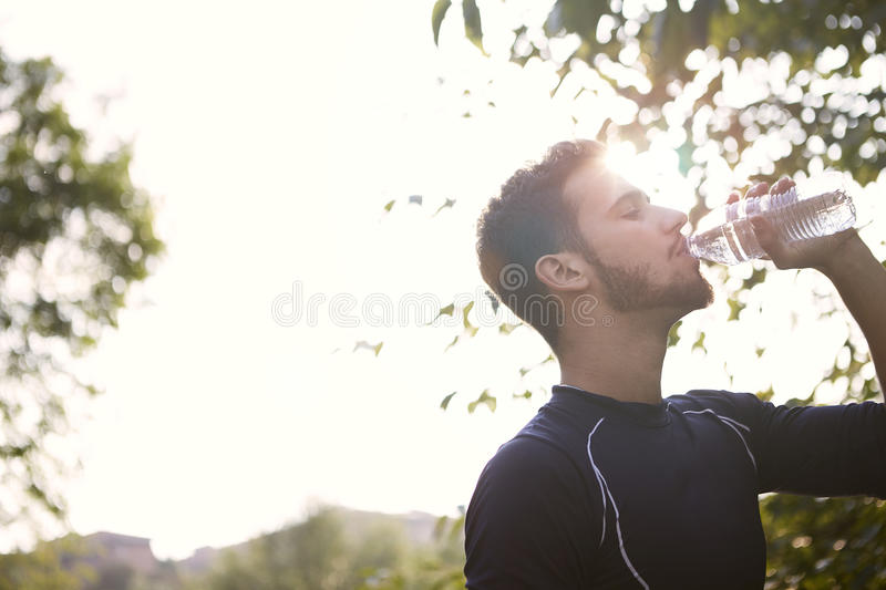 Download Man drinking water stock photo. Image of country, smile - 89657820