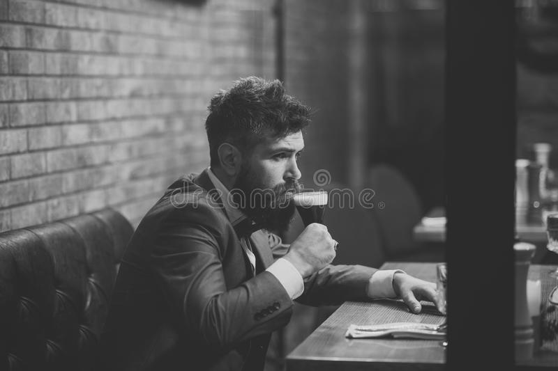 Man drinks cognac. Beer time. Man drinking beer in restaurant at meeting or date stock photos
