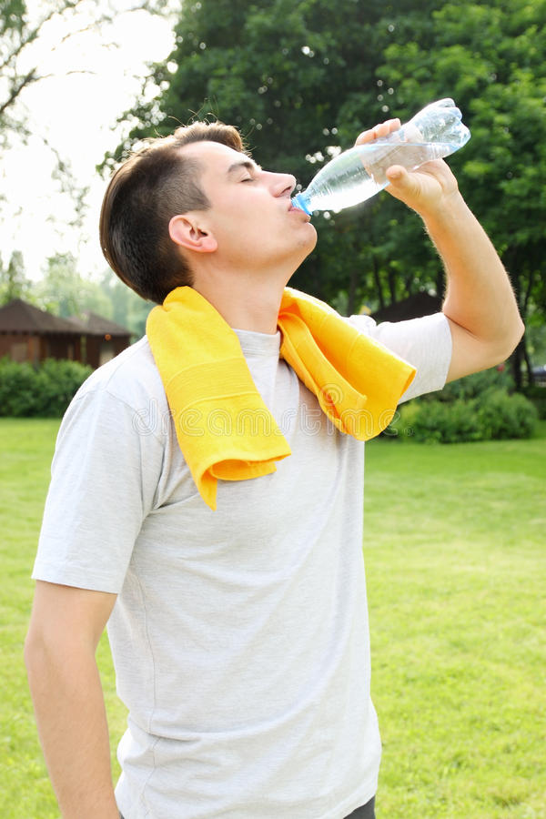 Man drinks water from a bottle