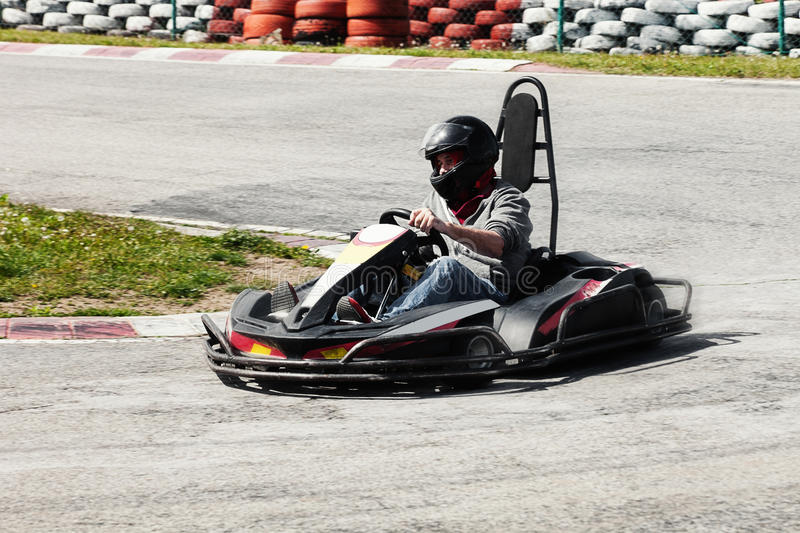 Man drive go kart on track back view royalty free stock photo