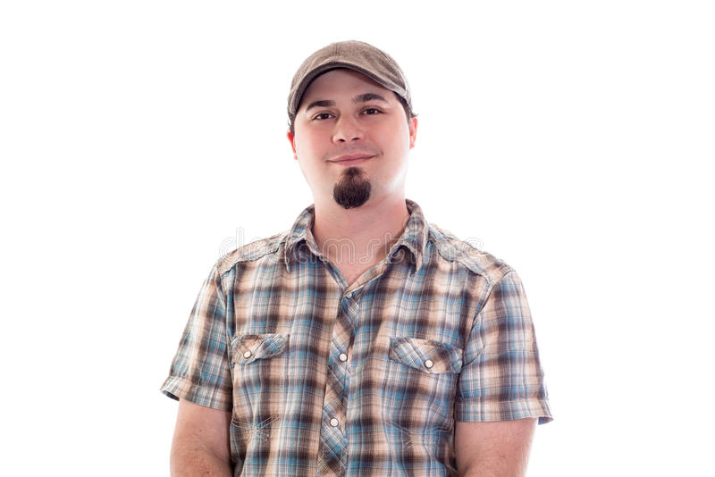 Man with driver cap and plaid shirt smiling. Man in 30's with driver's cap and plaid shirt smiling. Casual royalty free stock photo