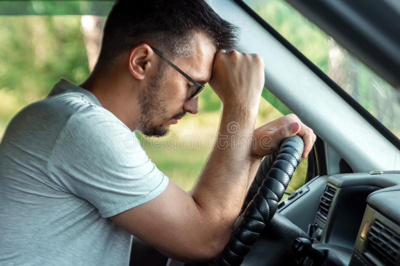 The man, the driver of the car fell asleep at the wheel during the trip. Emergency, accident, violation of rights stock images