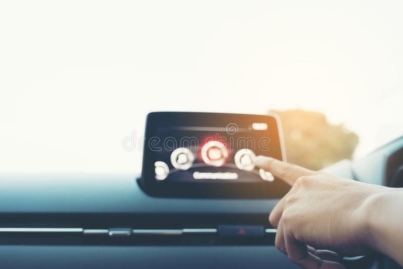 Man Driver entering an address into the navigation system, male. Hand pointing finger to car icon on control panel screen, hand touching to multimedia system royalty free stock photography
