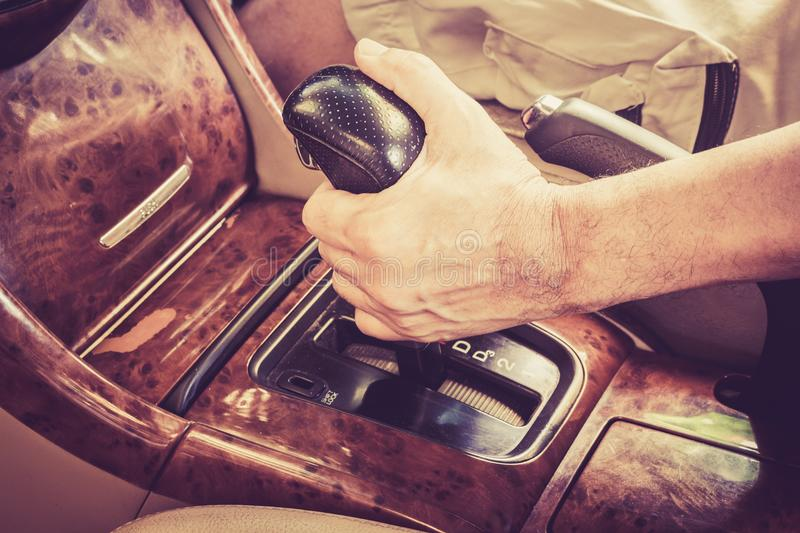 Man driver hand shifting gear stick. Man driver hand shifting the gear stick stock images