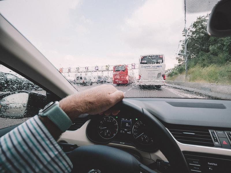 Man driving car approaching toll road royalty free stock photo