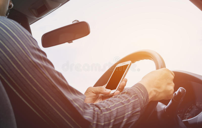Man driving car. Hands of male is driver on steering wheel car. Vintage style royalty free stock images