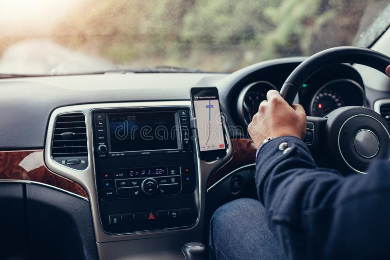 Male Hand Using Navigation System On Car Dashboard Stock