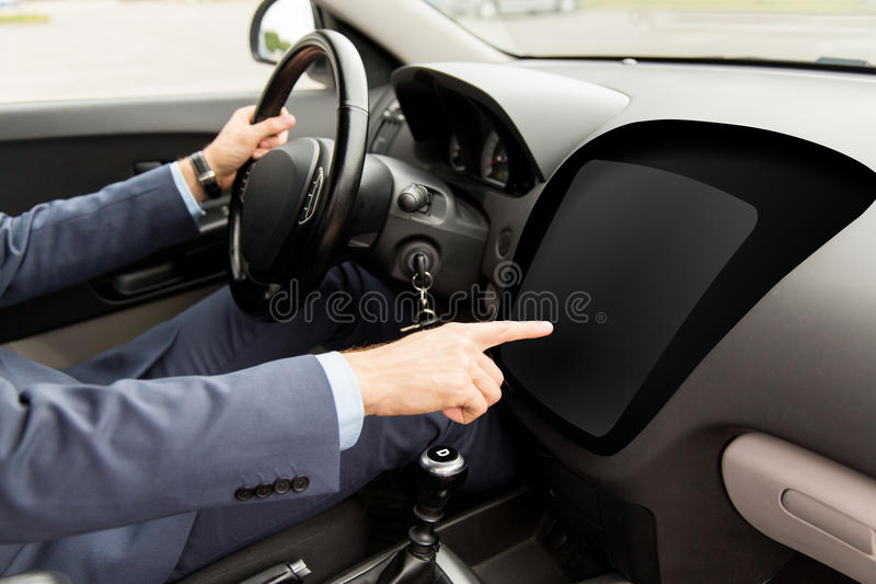 Man driving car and pointing to on-board computer royalty free stock photos