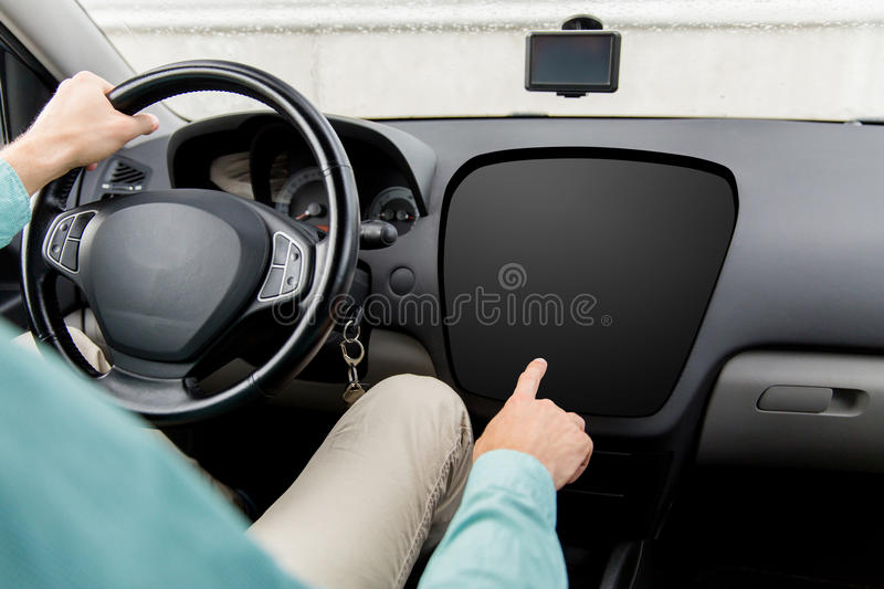 Man driving car and pointing to on-board computer royalty free stock image