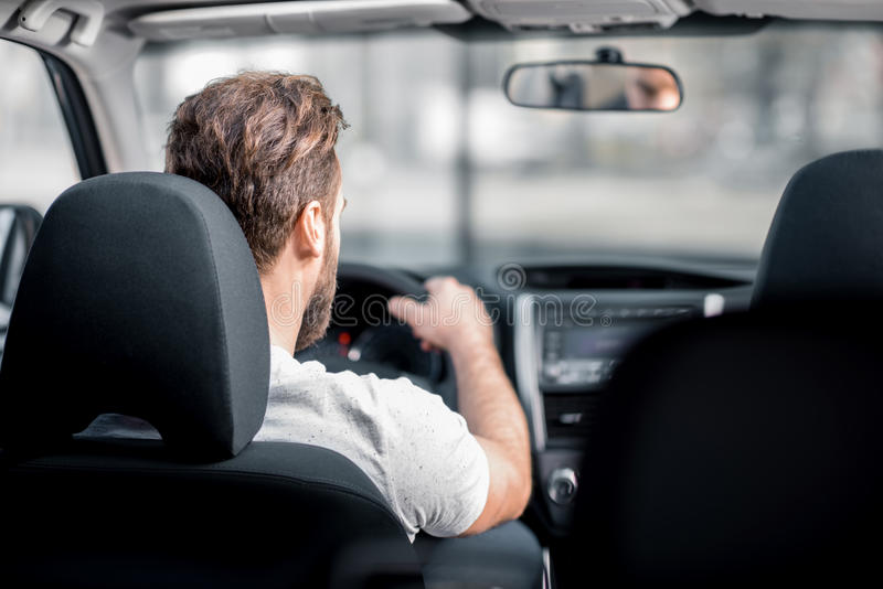 Man driving a car stock image