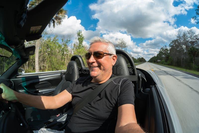Man driving stock photo