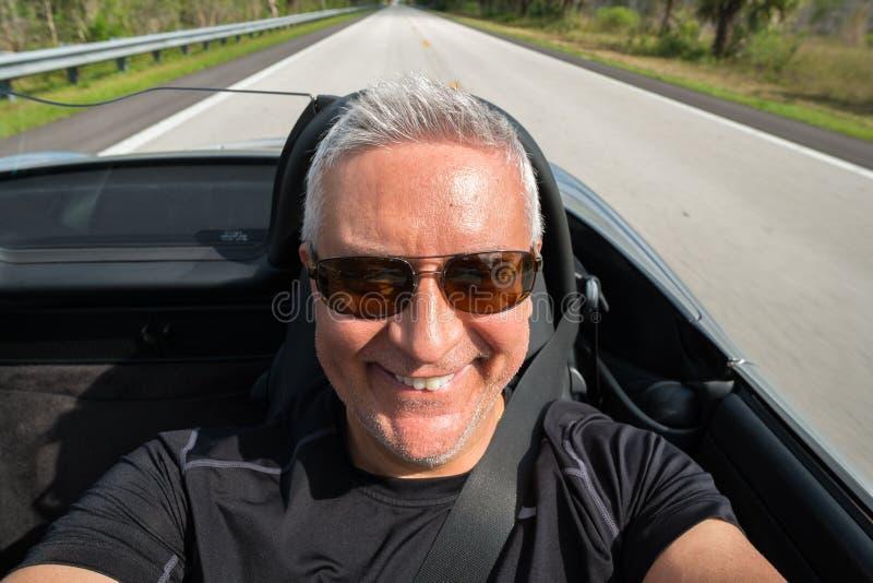 Man driving stock image