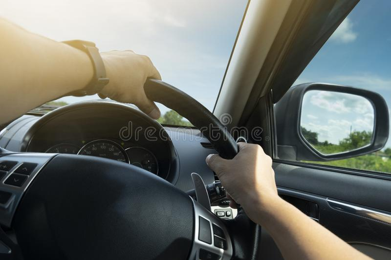 Man driving inside car on the road. royalty free stock photography