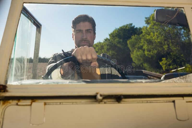 Man driving off road vehicle seen through windshield. Young man driving off road vehicle seen through windshield at forest royalty free stock photos