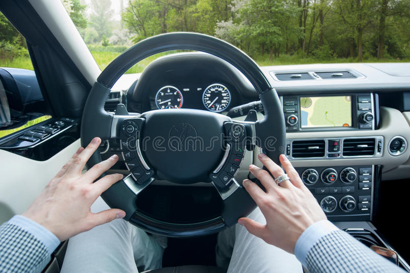 Man driving offroad car. stock images