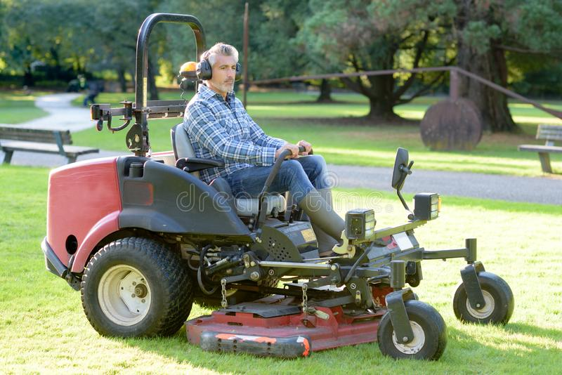 Man driving professional mower. Driver royalty free stock photos