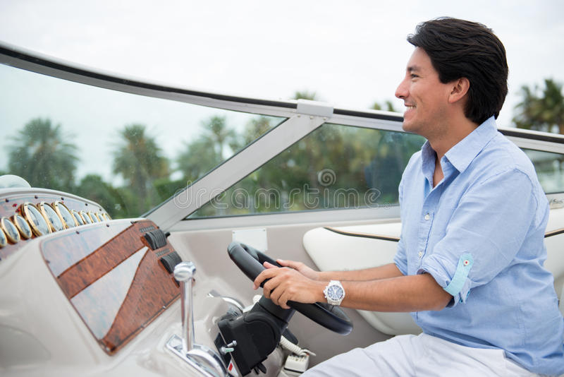 Download Man driving a yacht stock photo. Image of driving, casual - 30506252
