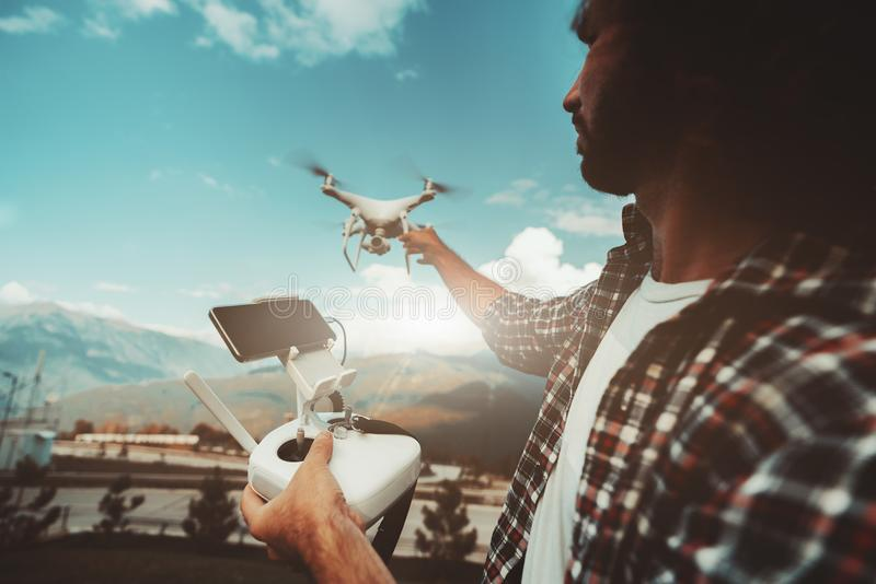Man with drone and remote controller is preparing to film royalty free stock photography