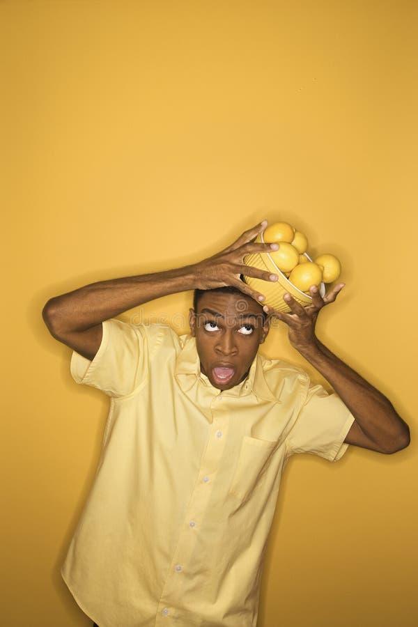 Free Man Dropping Bowl Of Lemons Balancing On His Head. Stock Photo - 2037090