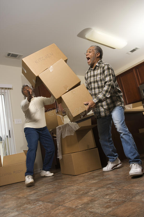 Download Man Dropping Stack Of Boxes Stock Photo - Image of length, expression: 12658214