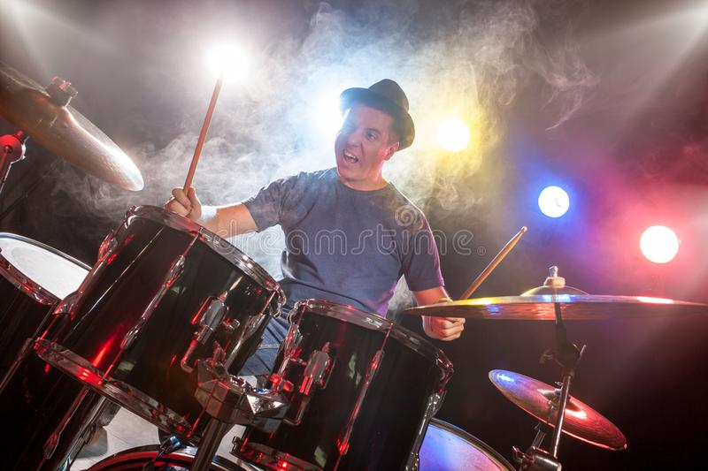 Male musician with drumsticks playing drums royalty free stock photos