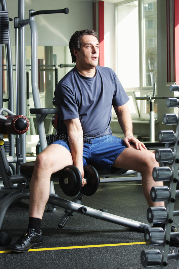 Download Man with dumb-bell stock image. Image of muscles, training - 14448605