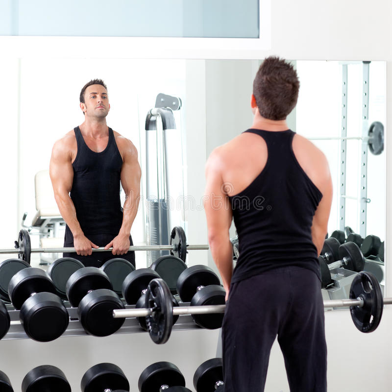 Free Weights Vs Machines: Man With Dumbbell Weight Training Equipment Gym Stock