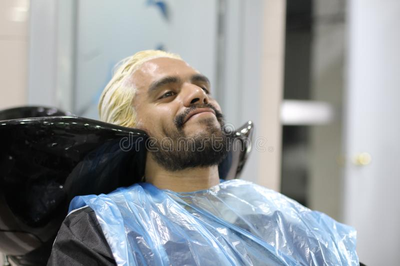 Man dying his hair at a salon stock photography