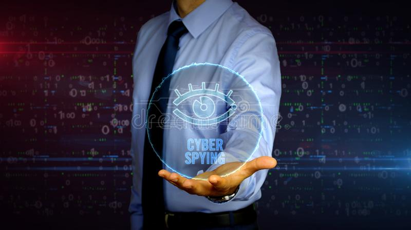 Businessman with spy eye symbol hologram. Man with dynamic cyber eye symbol hologram on hand. Businessman showing futuristic concept of digital surveillance royalty free stock image