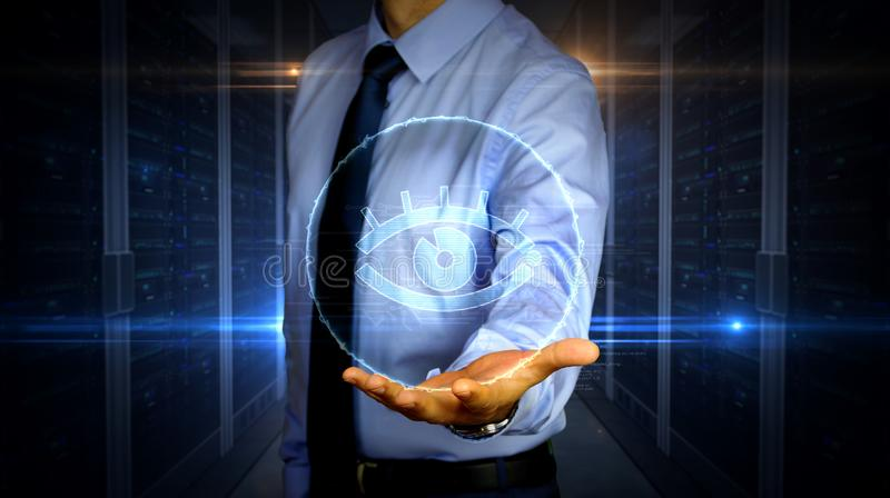 Businessman with spy eye symbol hologram. Man with dynamic cyber eye symbol hologram on hand. Businessman showing futuristic concept of digital surveillance stock photos