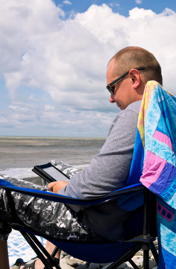 Man with e-book