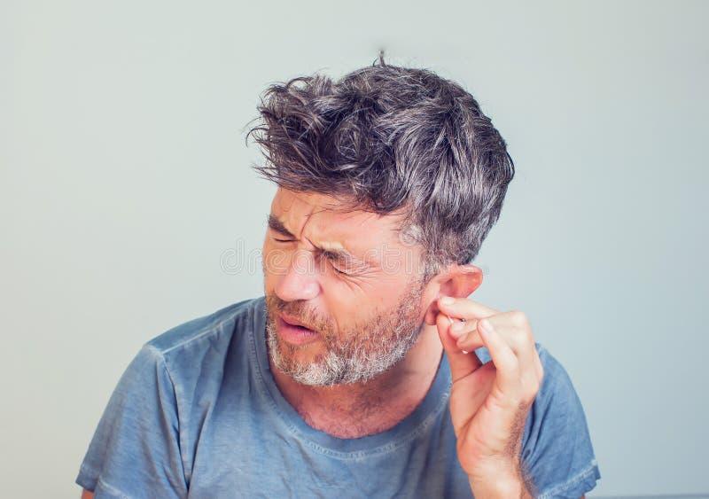 Man with ear sticks stock photos
