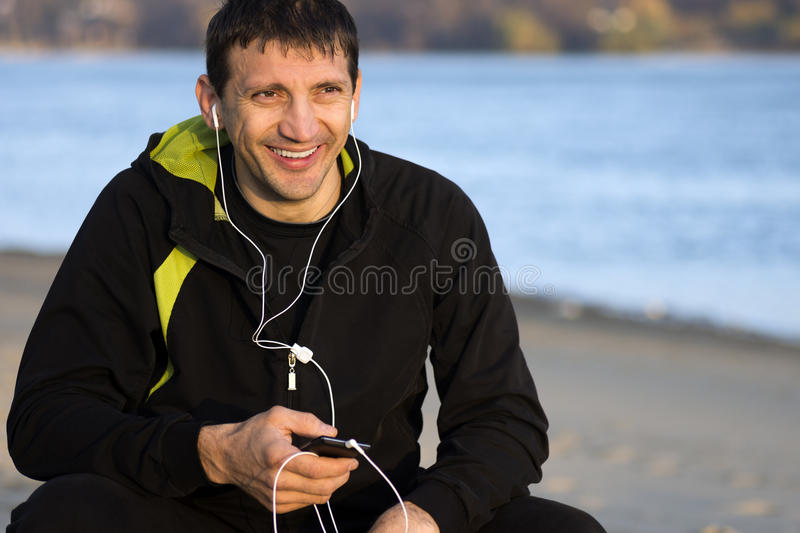 Man with earphones royalty free stock images