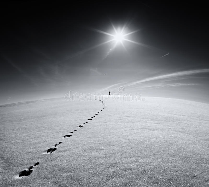 Free Man.Earth.Universe.Lonely Man Walking On Snow Crust Field On The Trail Of A Hare On The Background Of The Sun And The Flying Plane Stock Images - 91842474