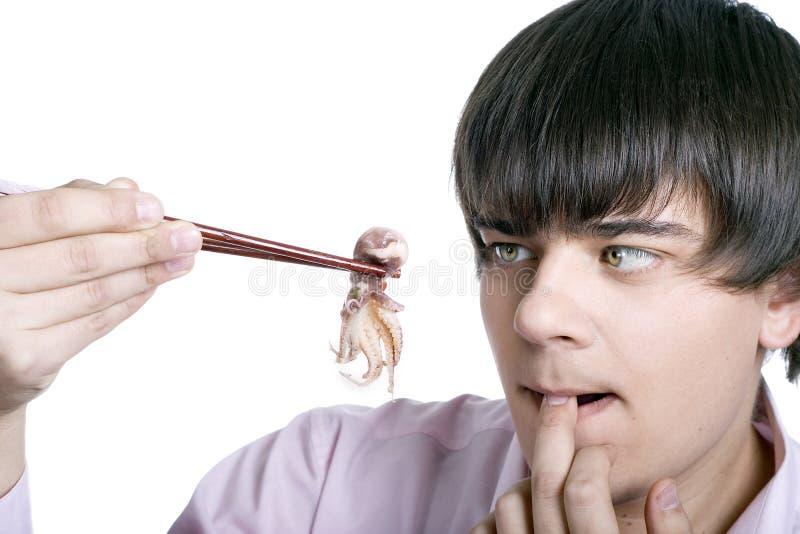 Man eat squid stock photos