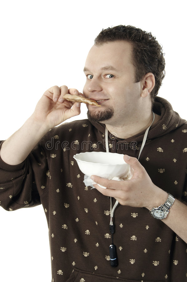 Man eating. A piece of meat, isolated on white stock photography