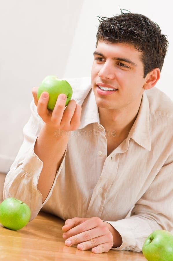 Man eating apples stock photo