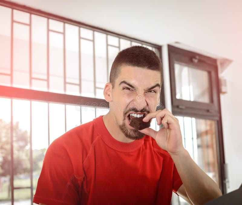 Man eating chocolate stock photography