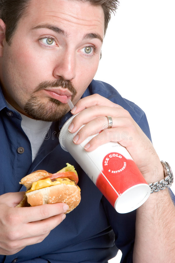 Man Eating Fast Food. Hungry man eating fast food stock image