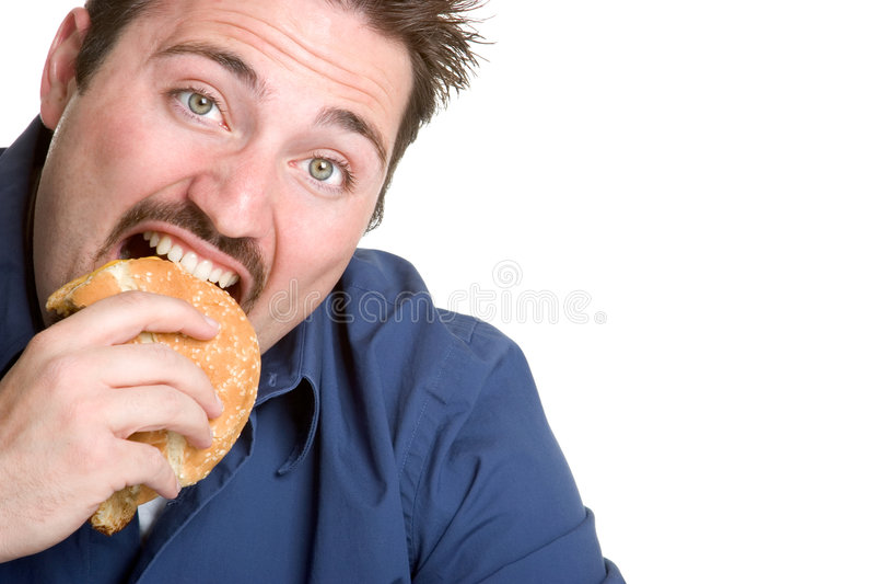 Man Eating Hamburger. Isolated young man eating hamburger stock photography