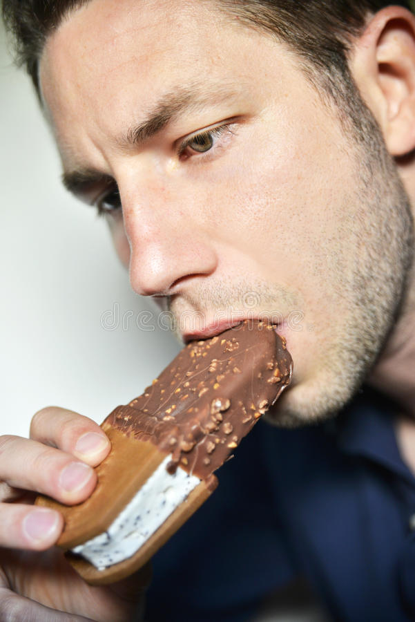 Download Man eating ice-cream stock photo. Image of refresh, taste - 31628784