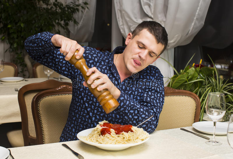 Man eating a large portion of pasta. In a restaurant royalty free stock images