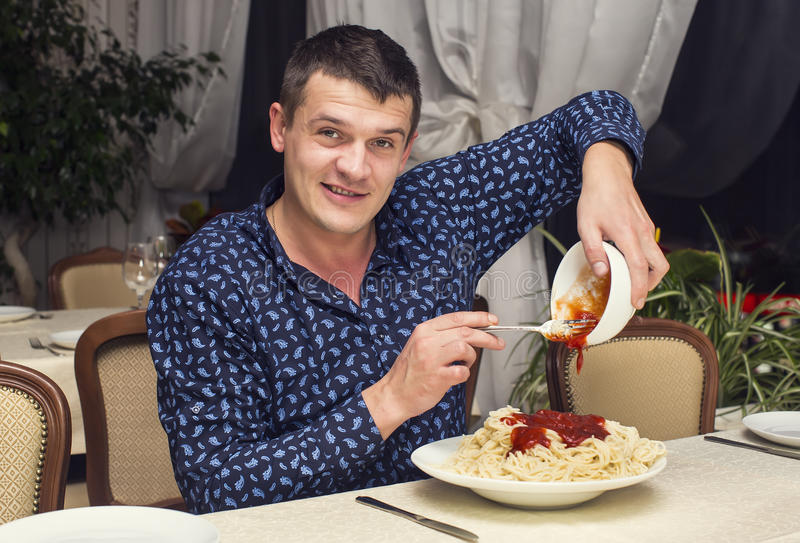 Man eating a large portion of pasta. In a restaurant royalty free stock photo