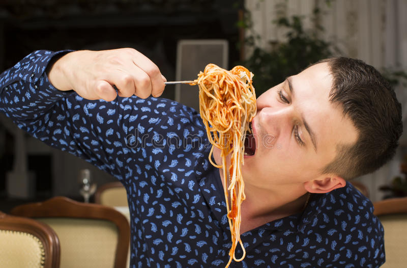 Man eating a large portion of pasta. In a restaurant royalty free stock photos