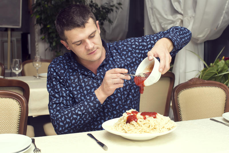 Man eating a large portion of pasta. In a restaurant royalty free stock image